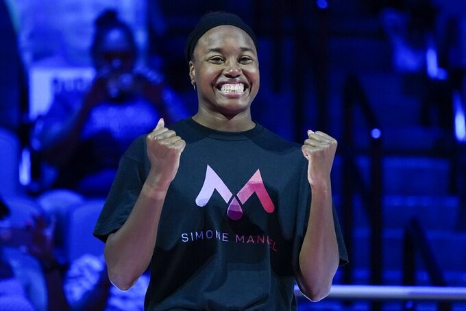 Simone Manuel reacts at the medal ceremony for the women's 50 freestyle during wave 2 of the U.S. Olympic Swim Trials on Sunday, June 20, 2021, in Omaha, Neb. (AP Photo/Charlie Neibergall)