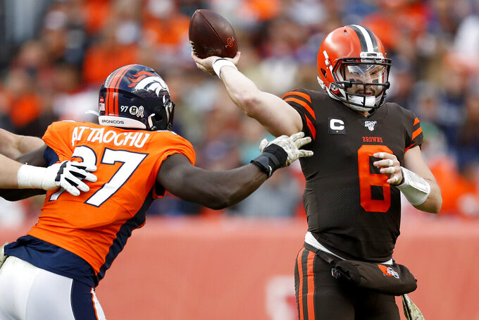 Cleveland Browns quarterback Baker Mayfield (6) throws under pressure from Denver Broncos linebacker Jeremiah Attaochu (97) during the first half of NFL football game, Sunday, Nov. 3, 2019, in Denver. (AP Photo/David Zalubowski)