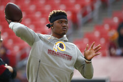 Washington Redskins quarterback Dwayne Haskins works out prior to an NFL football game against the New York Giants, Sunday, Dec. 22, 2019, in Landover, Md. (AP Photo/Alex Brandon)