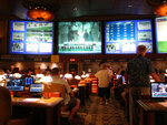 Bettors wait to make wagers on sporting events at the Borgata casino in Atlantic City, N.J., Thursday, June 14, 2018,  hours after it began accepting sports bets. (AP Photo/Wayne Parry)