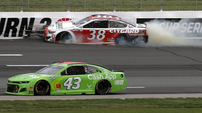 Driver John Hunter Nemechek (38) bangs into the wall after losing a tire as Bubba Wallace (43) passes safely below during a NASCAR Cup Series auto race, Sunday, Aug. 2, 2020, at the New Hampshire Motor Speedway in Loudon, N.H. (AP Photo/Charles Krupa)