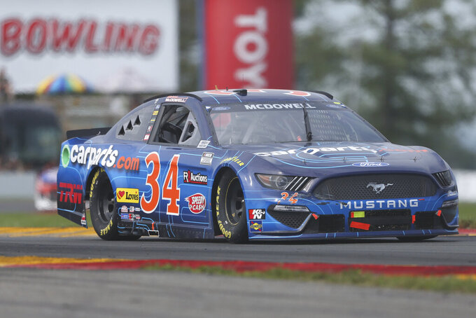 Michael McDowell drives through the Bus Stop during a NASCAR Cup Series auto race in Watkins Glen, N.Y., on Sunday, Aug. 8, 2021. (AP Photo/Joshua Bessex)