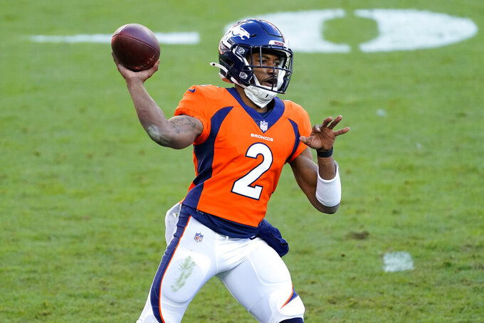 FILE - In this Nov. 29, 2020, file photo, Denver Broncos quarterback Kendall Hinton throws against the New Orleans Saints during the first half of an NFL football game in Denver. Hinton's start at quarterback may not have been memorable, but his moment in the spotlight is memorialized in the Pro Football Hall of Fame on practice fields  across the NFL. (AP Photo/Jack Dempsey, File)
