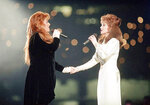 FILE - Wynonna Judd, left, and her mother Naomi Judd, of The Judds, perform during the halftime show at Super Bowl XXVIII in Atlanta on Jan. 30, 1994. The Grammy-winning duo will be inducted into the Country Music Hall of Fame.  (AP Photo/Eric Draper, File)