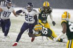 Tennessee Titans' Derrick Henry runs during the first half of an NFL football game against the Green Bay Packers Sunday, Dec. 27, 2020, in Green Bay, Wis. (AP Photo/Matt Ludtke)