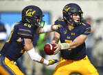 California quarterback Chase Garbers, right, hands off the ball to Patrick Laird (28) during the first half of an NCAA college football game against Washington Saturday, Oct. 27, 2018, in Berkeley, Calif. (AP Photo/Ben Margot)