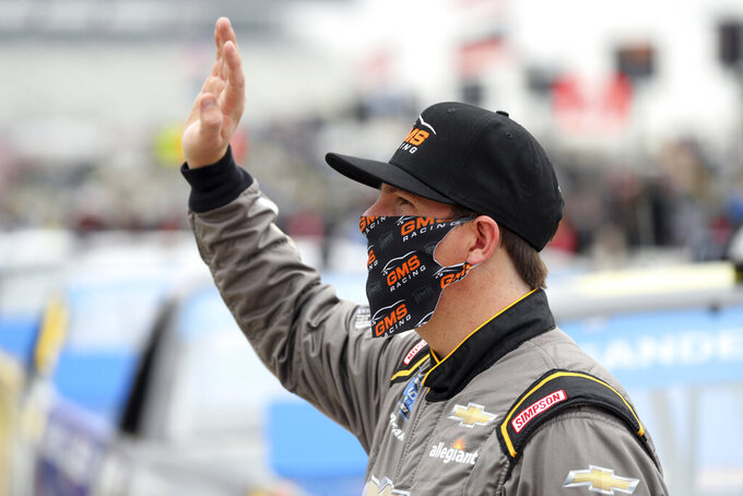 NASCAR Texas Trucks Series driver Sheldon Creed (2) waves to the fans from pit road before a NASCAR Cup Series auto race at Texas Motor Speedway in Fort Worth, Texas, Sunday, Oct. 25, 2020. (AP Photo/Richard W. Rodriguez)