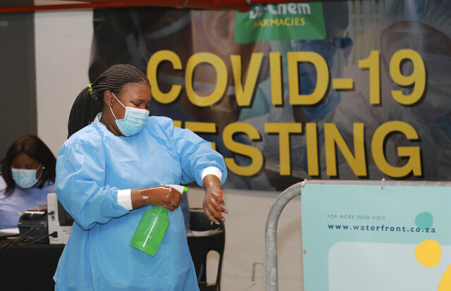 A health-care worker sanitises her hands before conducting COVID-19 tests at a Dis-Chem drive-through testing station at the V&A Waterfront in Cape Town, South Africa, Friday, Jan. 8, 2021. South Africa with 60 million people has reported by far the most cases of the coronavirus in Africa, with more than 1.1 million confirmed infections. (AP Photo/Nardus Engelbrecht)