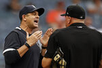 New York Yankees manager Aaron Boone, left, argues with home plate umpire Jeff Nelson after being ejected from a baseball game against the Baltimore Orioles during the fifth inning Sunday, Sept. 5, 2021, in New York. (AP Photo/Adam Hunger)