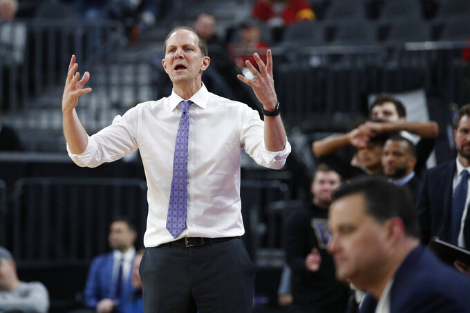 Washington head coach Mike Hopkins motions towards the court during the second half of an NCAA college basketball game against Arizona in the first round of the Pac-12 men's tournament Wednesday, March 11, 2020, in Las Vegas. (AP Photo/John Locher)