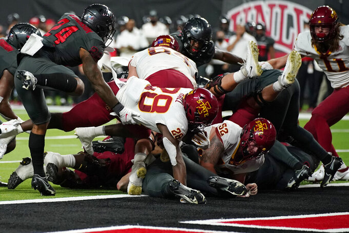 Iowa State running back Breece Hall (28) dives into the end zone for a touchdown against the UNLV during the first half of an NCAA college football game Saturday, Sept. 18, 2021, in Las Vegas. (AP Photo/John Locher)