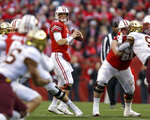 Wisconsin quarterback Alex Hornibrook, center, looks to pass against Minnesota during the first half of an NCAA college football game Saturday, Nov. 24, 2018, in Madison, Wis. (AP Photo/Andy Manis)