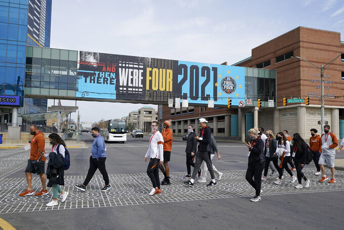 The Texas basketball walks to Victory Field, Wednesday, March 17, 2021, in Indianapolis. (AP Photo/Darron Cummings)