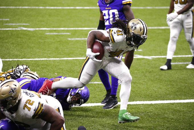 New Orleans Saints running back Alvin Kamara (41) crosses into the end zone for his fifth touchdown of the game, in the second half of an NFL football game against the Minnesota Vikings54 in New Orleans, Friday, Dec. 25, 2020. (AP Photo/Butch Dill)