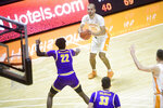 Tennessee's Santiago Vescovi (25) takes a shot while defended by Tennessee Tech's Tujautae Williams (22) during an NCAA college basketball game Friday, Dec. 18, 2020, in Knoxville, Tenn. (Caitie McMekin/Knoxville News Sentinel via AP, Pool)