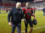 North Carolina State coach Dave Doeren laughs with quarterback Bailey Hockman (16) after the team's 38-22 victory over Florida Stateof an NCAA college football game Saturday, Nov. 14, 2020, in Raleigh, N.C. (Ethan Hyman/The News & Observer via AP, Pool)