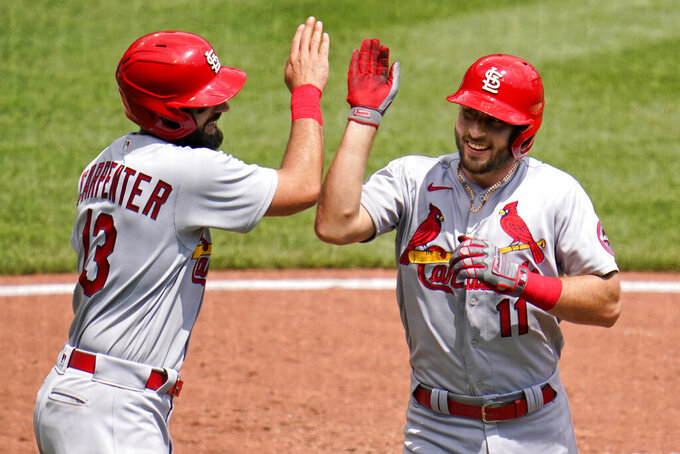 St. Louis Cardinals' Paul DeJong (11) celebrates with Matt Carpenter after hitting a two-run home run off Pittsburgh Pirates starting pitcher JT Brubaker during the fourth inning of a baseball game in Pittsburgh, Thursday, Aug. 12, 2021. (AP Photo/Gene J. Puskar)