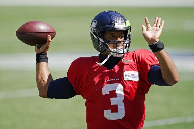 Seattle Seahawks quarterback Russell Wilson passes warms up for the team's NFL football scrimmage Wednesday, Aug. 26, 2020, in Seattle. (AP Photo/Ted S. Warren)