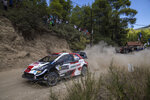 Elfyn Evans and co-driver Martin Scott Great Britain in their Toyota Yaris WRC car compete in the WRC Acropolis Rally at the stage of Aghii Theodori, west of Athens, on Friday, Sept. 10, 2021. The World Rally Championship returned to Greece after an eight-year absence. (AP Photo/Petros Giannakouris)