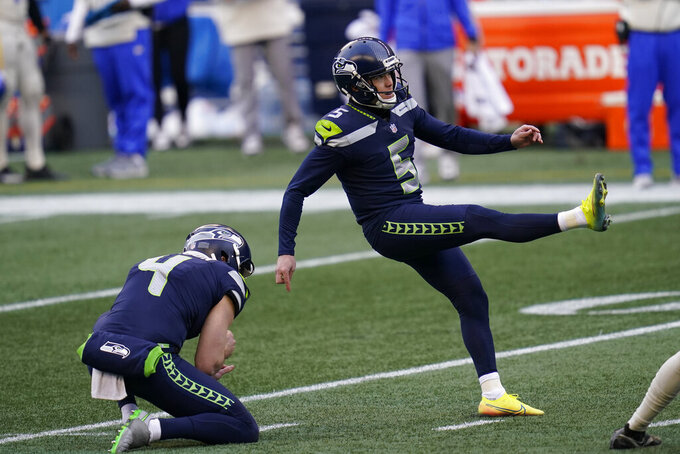 Seattle Seahawks kicker Jason Myers (5) kicks a field goal against the Los Angeles Rams during the first half of an NFL football game, Sunday, Dec. 27, 2020, in Seattle. (AP Photo/Elaine Thompson)