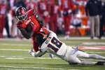 Oregon State defensive back Alex Austin (18) tackles Utah running back Devin Brumfield (6) during the first half of an NCAA college football game Saturday, Dec. 5, 2020, in Salt Lake City. (AP Photo/Rick Bowmer)