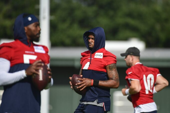 Texans quarterback Deshaun Watson (4) works out with the quarterbacks during NFL football practice Monday, Aug. 2, 2021, in Houston. (AP Photo/Justin Rex)