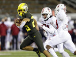 Oregon's Travis Dye, left, beaks for a big run during the fourth quarter against Stanford during the first quarter of an NCAA college football game Saturday, Nov. 7, 2020, in Eugene, Ore. (AP Photo/Chris Pietsch)