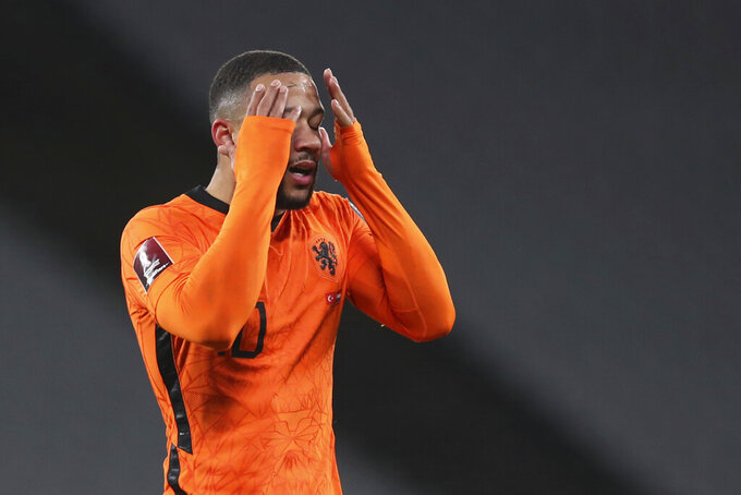Netherlands' Memphis Depay reacts after a missed scoring opportunity during the World Cup 2022 group G qualifying soccer match between Turkey and Netherlands at the Ataturk Olimpiyat Stadium in Istanbul, Turkey, Wednesday, March 24, 2021. (Tolga Bozoglu/Pool Photo via AP)