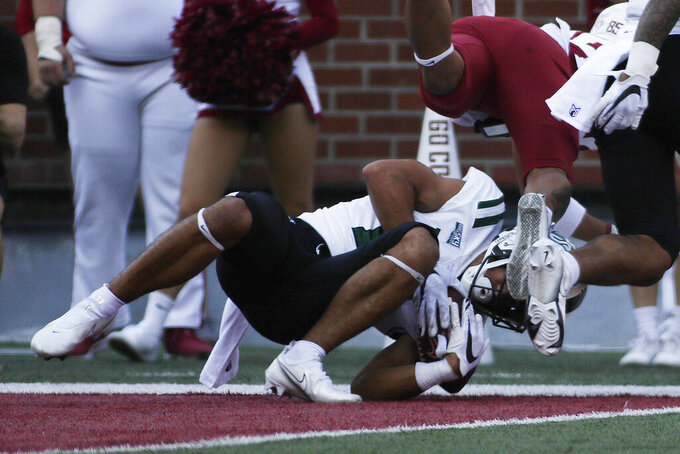 Portland State cornerback Anthony Adams, left, intercepts a Washington State pass during the first half of an NCAA college football game, Saturday, Sept. 11, 2021, in Pullman, Wash. (AP Photo/Young Kwak)