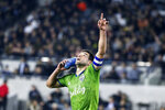 Seattle Sounders midfielder Nicolas Lodeiro celebrates his goal while holding his shoe during the first half of the team's MLS soccer Western Conference final against Los Angeles FC, Tuesday, Oct. 29, 2019, in Los Angeles. (AP Photo/Ringo H.W. Chiu)