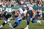 Detroit Lions' Matthew Stafford  (9) scrambles from the pocket during the second half of an NFL football game against the Philadelphia Eagles, Sunday, Sept. 22, 2019, in Philadelphia. (AP Photo/Michael Perez)