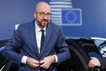 Belgian Prime Minister Charles Michel arrives for an EU summit in Brussels, Tuesday, July 2, 2019. European Union leaders continued a third day of talks to seek a breakthrough in a diplomatic fight over who should be picked for a half dozen of jobs at top EU institutions. (Geoffroy van der Hasselt, Pool Photo via AP)