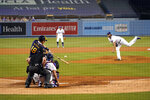 Milwaukee Brewers' Keston Hiura (18) singles off Los Angeles Dodgers starting pitcher Clayton Kershaw, right, during the fifth inning in Game 2 of a National League wild-card baseball series Thursday, Oct. 1, 2020, in Los Angeles. (AP Photo/Ashley Landis)