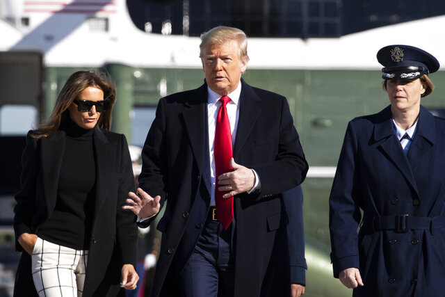 President Donald Trump, with first lady Melania Trump, wave as they walk across the tarmac to board Air Force One during their departure, Sunday, Feb. 23, 2020, at Andrews Air Force Base, Md. Trump is traveling to India. (AP Photo/Alex Brandon)