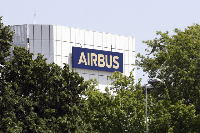 FILE - In this file photo dated Thursday, July 9, 2020, the logo of Airbus group is displayed in Toulouse, south of France.  European plane maker Airbus said Thursday July 30, 2020, its deliveries halved during the first six months of the year as travel collapsed during the coronavirus pandemic, with revenue sliding almost 40% to 18.9 billion euros. (AP Photo/Manuel Blondeau, FILE)