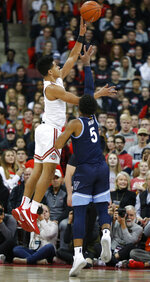 Ohio State's D.J. Carton, left, shoots over Villanova's Justin Moore during the first half of an NCAA college basketball game Wednesday, Nov. 13, 2019, in Columbus, Ohio. (AP Photo/Jay LaPrete)