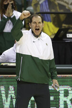 FILE - Baylor head coach Scott Drew reacts as his team scores in the second half of an NCAA college basketball game against Texas Tech in Waco, Texas, in this Sunday, March 7, 2021, file photo. Nobody will get a lump in their throat or start sizing up glass slippers for programs like these — Alabama, Illinois, Baylor.  They're not underdogs. They're hardly unknown. What they are is a group of new teams with well-recognized names in the NCAA Tournament, and they're hoping to keep making life hard on the programs that have long had a stranglehold on March.(AP Photo/Jerry Larson, File)
