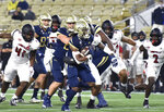 FKILE - Georgia Tech running back Jahmyr Gibbs breaks away for a touchdown against Louisville during the first half of an NCAA college football game in Atlanta, in this Friday, Oct. 9, 2020, file photo. One of the most versatile players in the country and a preseason All-ACC pick, he had 968 all-purpose yards and seven touchdowns while playing in only seven games because of injury for the 3-7 Yellow Jackets.  (Hyosub Shin/Atlanta Journal-Constitution via AP, File)