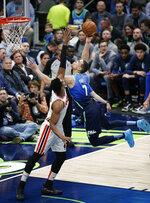 Dallas Mavericks forward Dwight Powell (7) attempts a shot as Portland Trail Blazers forward Hassan Whiteside (21) defends during the first half of an NBA basketball game Friday, Jan. 17, 2020, in Dallas. (AP Photo/Brandon Wade)