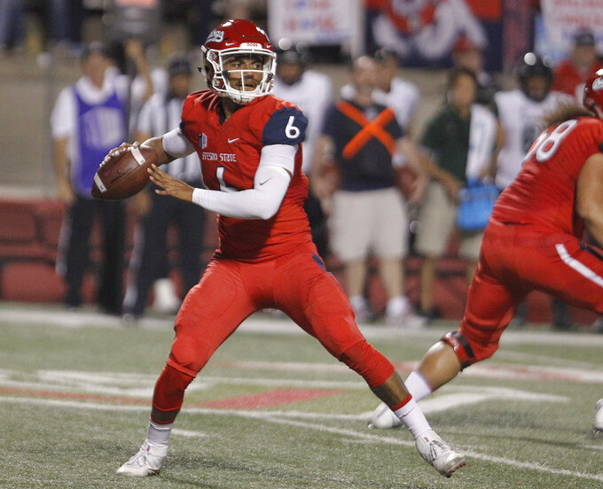 Fresno State quarterback Marcus McMaryion drops back to pass against Hawaii during the first half of an NCAA college football game in Fresno, Calif., Saturday, Oct. 27, 2018. (AP Photo/Gary Kazanjian)