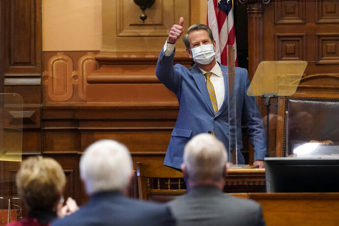 Georgia Gov. Brian Kemp gestures to lawmakers after delivering his State of the State address in the House Chambers Thursday, Jan. 14, 2021, in Atlanta. (AP Photo/John Bazemore)