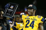 Kent State defensive back Qwuantrezz Knight (24) celebrates winning defensive MVP in the Frisco Bowl NCAA college football game against Utah State on Friday, Dec. 20, 2019, in Frisco, Texas. Kent State won 51-41. (AP Photo/Brandon Wade)