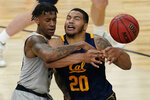 California's Matt Bradley (20) drives into Colorado's Eli Parquet (24) during the first half of an NCAA college basketball game in the quarterfinal round of the Pac-12 men's tournament Thursday, March 11, 2021, in Las Vegas. (AP Photo/John Locher)