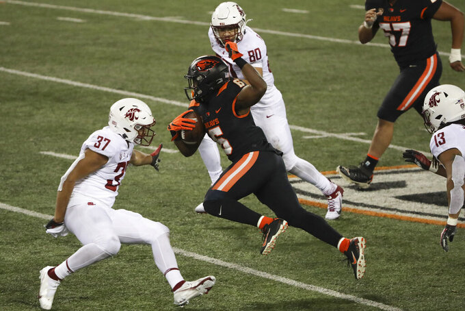 Oregon State running back Jermar Jefferson (6) weaves past Washington State linebacker Justus Rogers (37) and linebacker Brennan Jackson (80) during the second half of an NCAA college football game in Corvallis, Ore., Saturday, Nov. 7, 2020. Washington State won 38-28. (AP Photo/Amanda Loman)