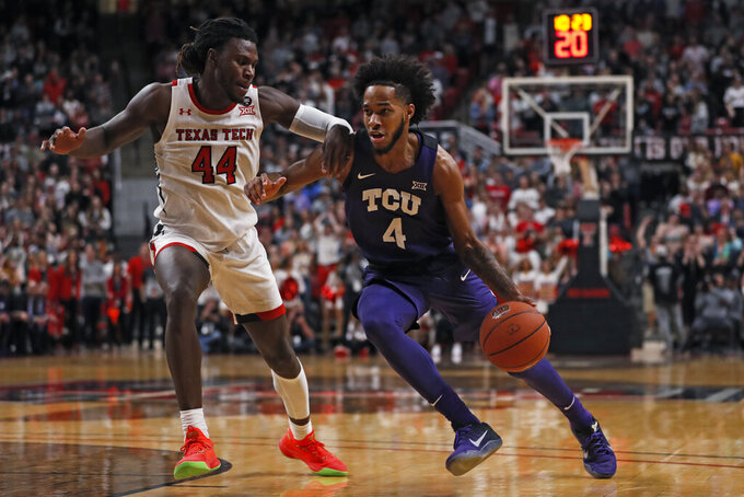 TCU's PJ Fuller (4) dribbles around Texas Tech's Chris Clarke (44) during the first half of an NCAA college basketball game Monday, Feb. 10, 2020, in Lubbock, Texas. (AP Photo/Brad Tollefson)