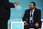 Lebanese Prime Minister Saad Hariri listens as a moderator gestures toward him while emphatically asking a question about how to pitch Lebanon to investors, during the World Government Summit in Dubai, United Arab Emirates, Sunday, Feb. 10, 2019. Hariri on Sunday urged the summit to invest in Lebanon as it faces an economic crisis that has seen thousands of people laid off and one of the highest public debts in the world. (AP Photo/Jon Gambrell)