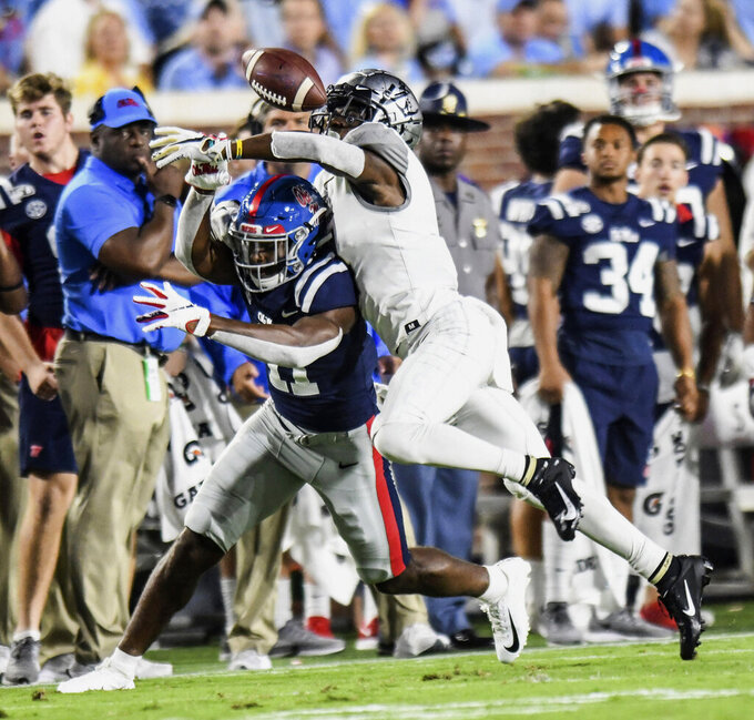 Vanderbilt defensive back Randall Haynie (4) knocks the ball away from Mississippi wide receiver Dontario Drummond (11) for an incomplete pass during an NCAA college football game in Oxford, Oxford, Miss., Saturday, Oct. 5, 2019. (Bruce Newman/The Oxford Eagle via AP)