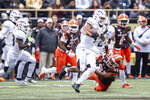 Western Michigan Broncos cornerback Patrick Lupro (4) returns an interception against Bowling Green Falcons during the second quarter of an NCAA college football game in Kalamazoo, Mich., on Saturday, Oct. 26, 2019. (Joel Bissell/Kalamazoo Gazette via AP)