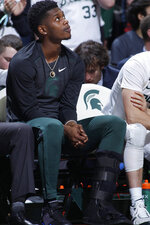 Michigan State's Rocket Watts watches from the bench against Rutgers during the first half of an NCAA college basketball game, Sunday, Dec. 8, 2019, in East Lansing, Mich. (AP Photo/Al Goldis)