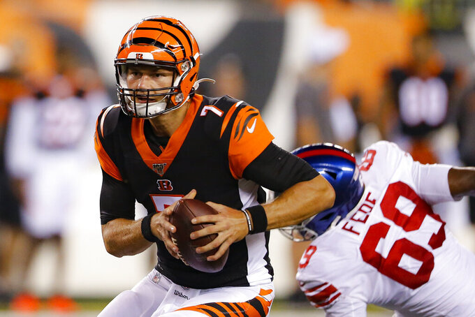 Cincinnati Bengals quarterback Jake Dolegala (7) runs the ball during the second half of the team's NFL preseason football game against the New York Giants, Thursday, Aug. 22, 2019, in Cincinnati. (AP Photo/Gary Landers)